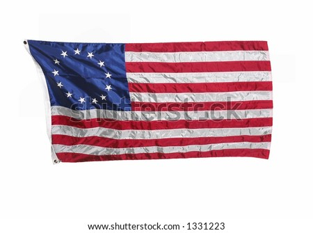 13 colonies flag of the United States of America. Horizontal composition isolated on white, plenty of room for copy space. The blue field in upper left has circle of 13 stars and there are 13 stripes - stock photo