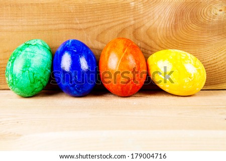 Colored eggs on wood