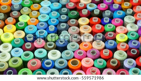 colored spools of thread
