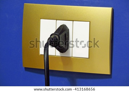 Colorful wall outlet plugged - stock photo