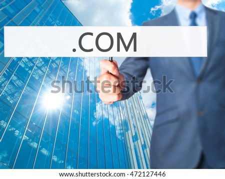 .COM - Businessman hand holding sign. Business, technology, internet concept. Stock Photo