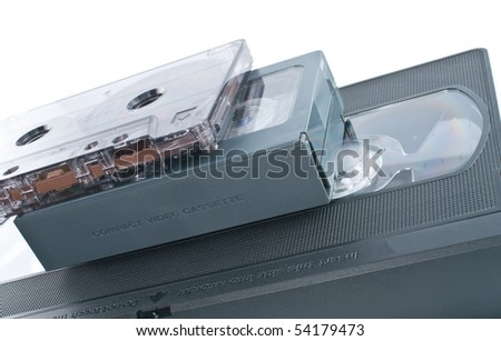 Compact videocassette, VHS and audio cassette  isolated on white background - stock photo