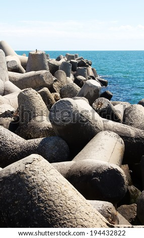 Concrete blocks for protection of coast - stock photo