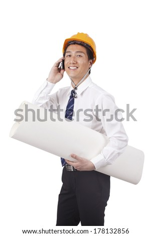 Construction management holding blueprints and using phone