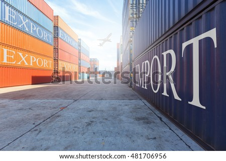 Containers box at  yard import - export concept with air plane background.