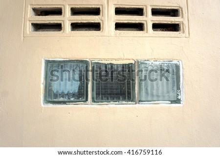 Contaminated paint glass blocks  at wall of building                              - stock photo