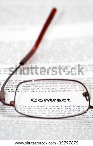"""Contract"" word focused thought glasses - stock photo"