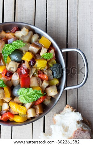 cooked vegetable salad made from chopped fried eggplant. Traditional sicilian dish. - stock photo