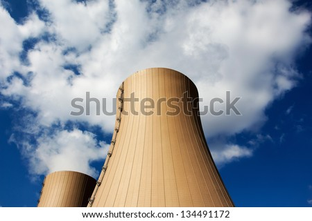 Cooling towers of nuclear power plant against a sky - stock photo