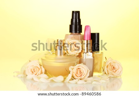 ?cosmetics with roses on yellow - stock photo