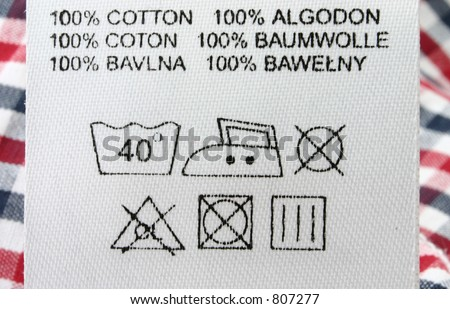 100% cotton  - real macro of clothing label #3 - stock photo