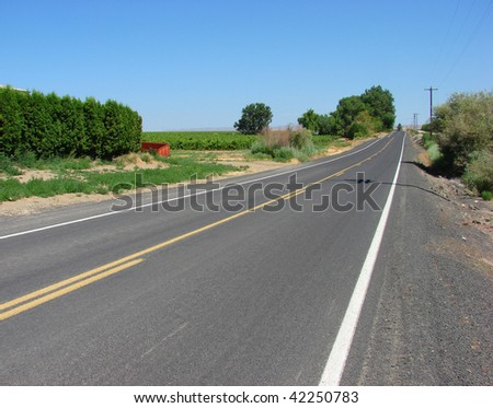country road with blue sky - stock photo