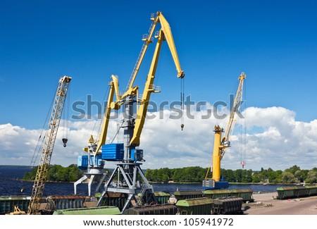 crane makes loading cargo in the port dock - stock photo