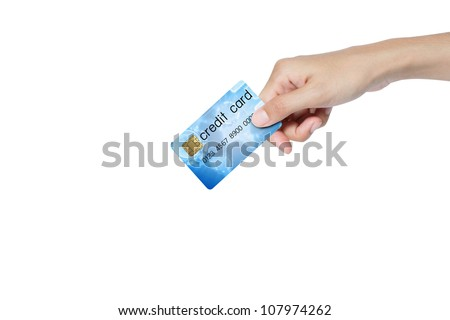 credit card holded by hand over blue background. - stock photo