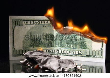 crisis, One hundred dollars in fire, burning dollar, ashes - stock photo