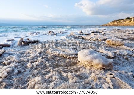 crystalline salt on beach of Dead Sea, Jordan - stock photo
