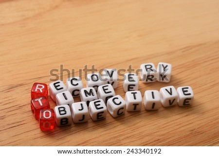 cubes with text , rto recovery time objective on wood - stock photo