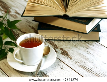 cup of tea and books on wooden - stock photo