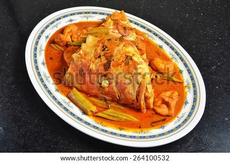Curry fish head , Traditional malaysian cuisine  - stock photo