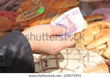 customer pays the vendor for purchases - stock photo