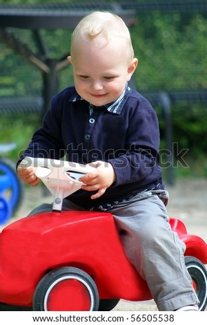 cute child with his car - stock photo