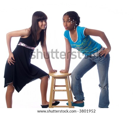 2 cute girls with different ethnic backgrounds - stock photo