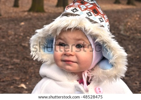 cute happy little baby with winter hat