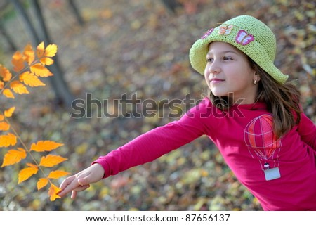 cute little girl in the park in autumn - stock photo