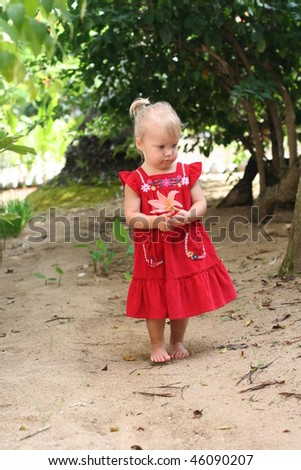 Cute 2 years old girl outdoors at sunny summer day - stock photo
