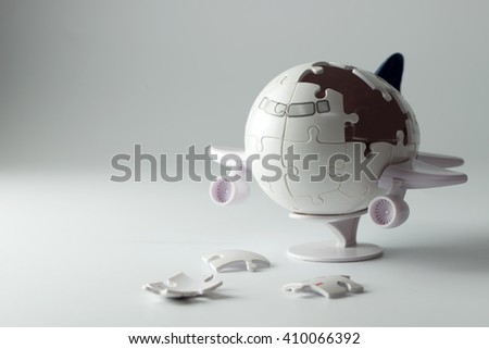 3D airplane puzzle with some incomplete pieces - stock photo
