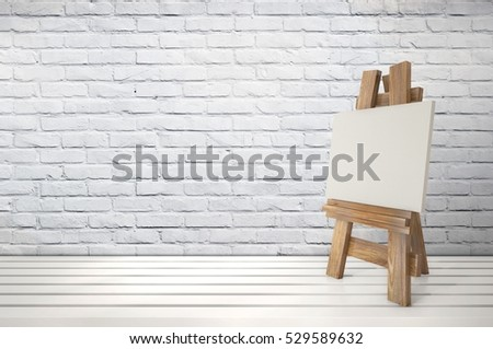 3d blank canvas with small  easel on white table 3D illustration