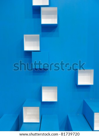 3D blue and white cubes in a random pattern on a blue background - stock photo