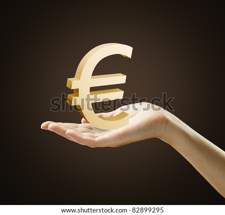 3d Gold Euro Sign on a woman's hand.Isolated on a black background - stock photo