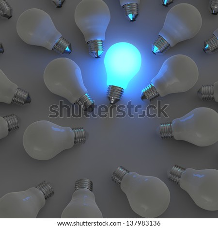 3d growing light bulb standing out from the unlit incandescent bulbs as leadership concept - stock photo