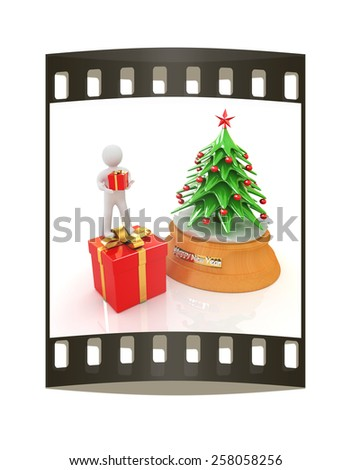 3D human, gift and Christmas tree on a white background. The film strip - stock photo