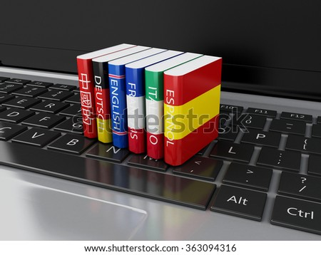 3d illustration. Dictionaries on computer keyboard. E-learning. Languages learn and translate, education concept. - stock photo