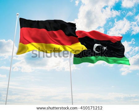 3D illustration of Germany & Libya Flags are waving in the sky - stock photo