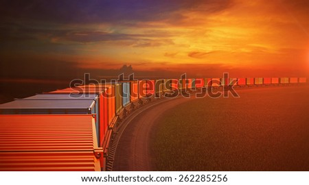 3d illustration of top view roofs of wagons of freight train with containers turning on railroad. Sky background - stock photo