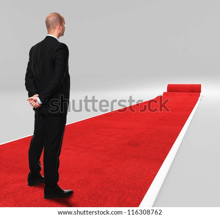 3d image of classic red carpet with standing man - stock photo