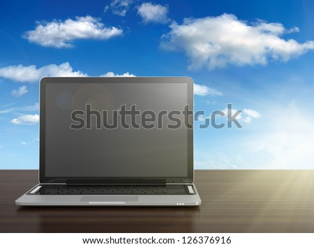 3D image of modern laptop with blank screen on wooden desk with blue sky on background - stock photo