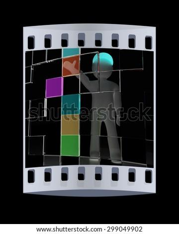3d man making choice, on black background. The film strip  - stock photo