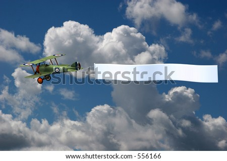 3D render of a biplane pulling a blank banner. The background is a photograph