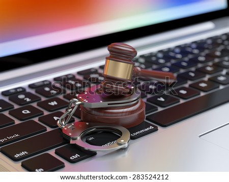 3d render of handcuffs and judge gavel on the laptop keyboard with soft focus - stock photo