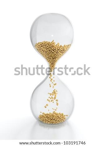 3D render of hourglass with golden grain - stock photo