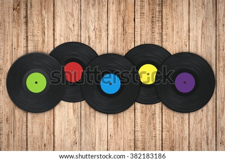 3d rendered black vinyl record on wooden background - stock photo
