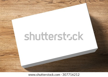 3d rendered stack of blank name cards on wooden background - stock photo