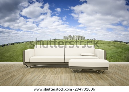 3D rendering of a sofa in front of a photo wall mural stonehenge - stock photo