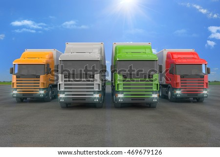 3d rendering of four colorful cargo trucks parked in a row with landscape in background.