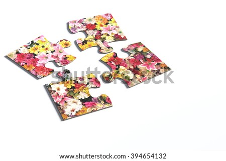 3d rendering of four puzzle pieces with flower print on white background. Isolated.