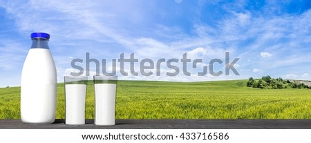 3D rendering of  milk glass bottle and glasses, with green fields and blue sky background.  - stock photo